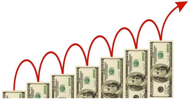 На фото – растущая диаграмма из долларовых купюр
